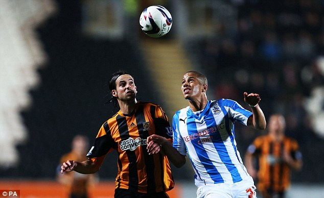 Aerial battle: George Boyd (left) and Huddersfield's Jake Carroll tussle