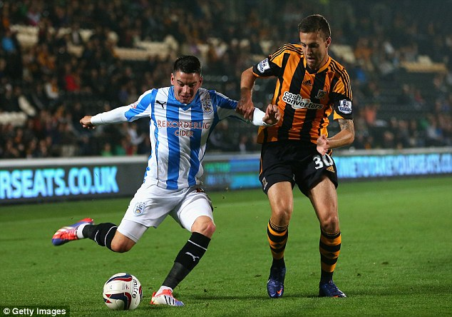 Level crossing: Adam Hammill of Huddersfield battles with Hull's Conor Henderson