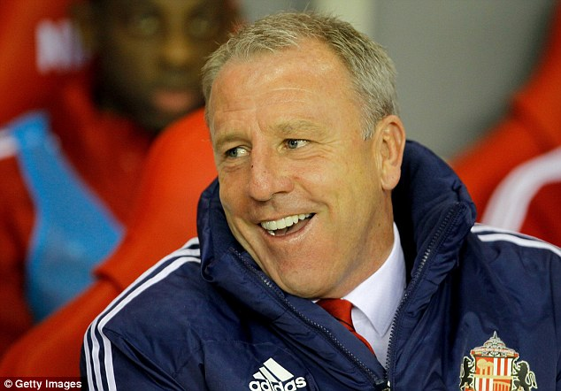 All smiles: Kevin Ball watches his first game in charge as caretaker manager at Sunderland