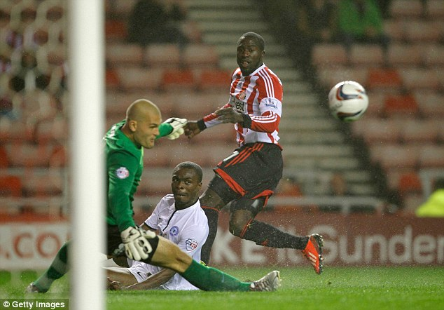 Scramble: Jozy Altidore of Sunderland competes with Bobby Olejnik and Gabriel Zakuani
