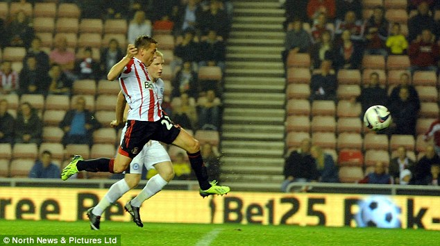 On target: Giaccherini scores the first goal of the night against Peterborough