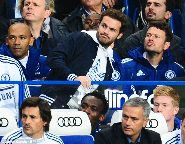Keen observer: Mata has been reduced to watching from the stands under Jose Mourinho