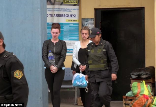 Police escort: The pair were handcuffed as they were taken from Virgen de Fatima Prison on the outskirts of the capital, to a court in the city centre wearing their own clothes