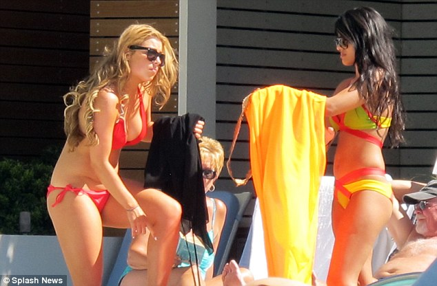 Colourful: The Essex girls certainly stood out with their colourful poolside fashion styles