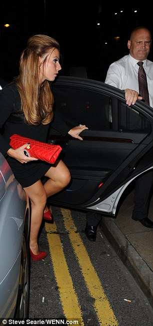 She's arrived: Coleen steps out of the taxi as she arrives at Rio Ferdinand's restaurant Rosso on King Street