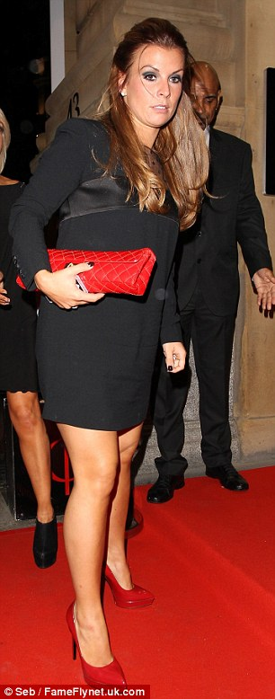 Hot stuff: Coleen looked stunning in an LBD with a sheer polka dot neckline, teamed with a red clutch bag and red pointed stilettos