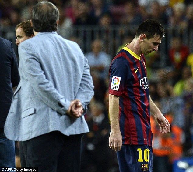 Not used to it: Lionel Messi was hauled off by Tata Martino (left) with ten minutes remaining, but he denies making any gesture