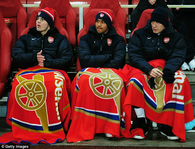 Frozen out: Bendtner (right) was often benched during his time at the Emirates