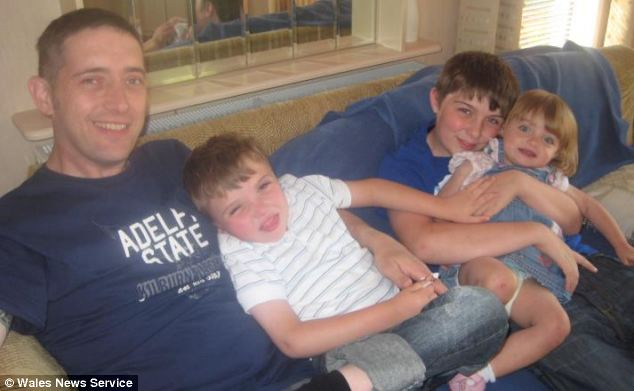 Louis (pictured with his father, Martin, brother, Adam, and sister, Hannah) was born six weeks early and was diagnosed with SMS when he was nine-weeks-old