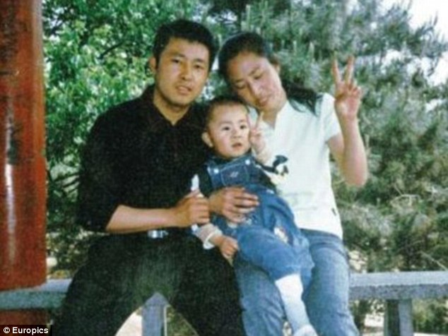 Family: Xia is here pictured with his son, now 12, and his wife Zhang Jing
