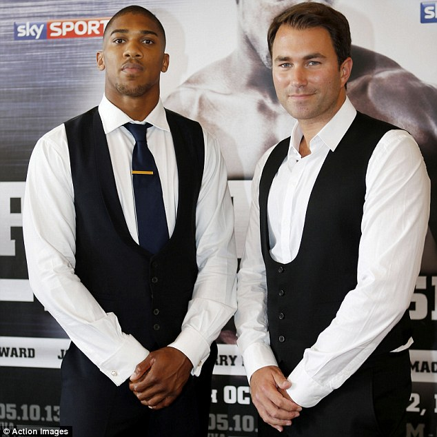 Hand-picked: Promoter Eddie Hearn (right) selected Emanuele Leo to take on Joshua (left) at the O2