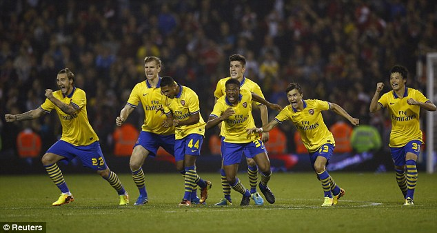 Cue celebrations: Monreal's Arsenal team-mates rushed to congratulate the Spaniard after his strike