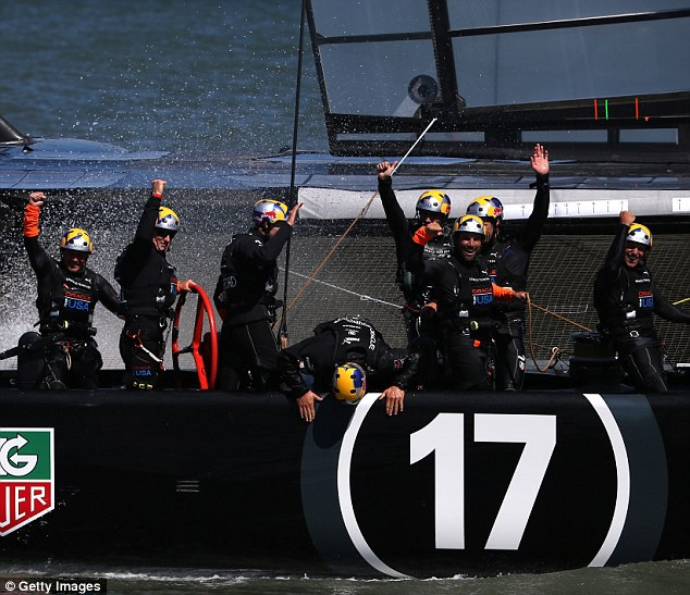 Oracle Team USA celebrates after beating Emirates Team New Zealand in the 34th America's Cup in the San Francisco Bay