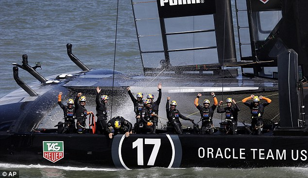 Splash: Oracle Team USA crew celebrates after winning the 19th race