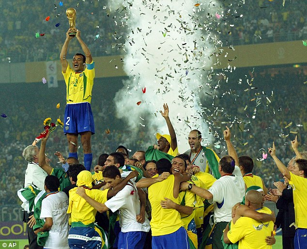 Finest hour: Cafu holds aloft the World Cup after Brazil beat Germany in Yokohama in 2002