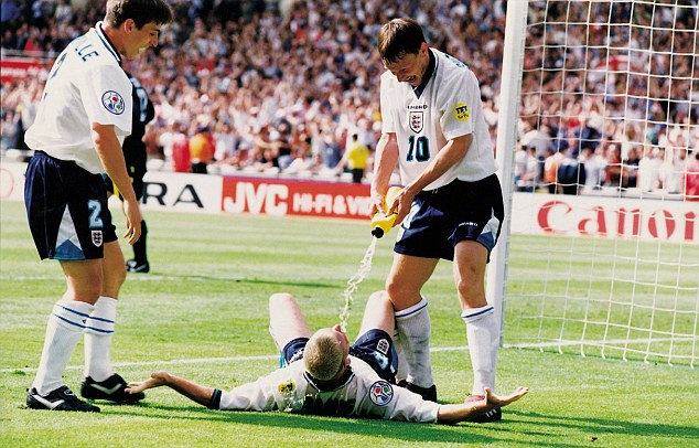 Dentist's chair: Teddy Sheringham and Gary Neville celebrate with Gascoigne after his superb strike