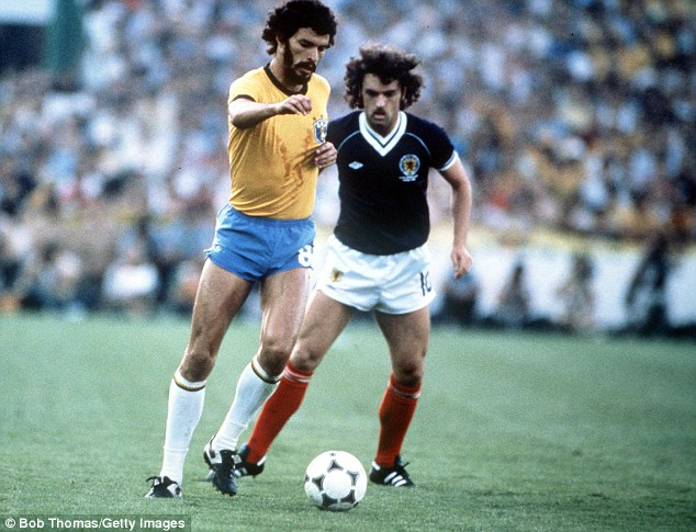 Legend: Socrates shows Scotland's John Wark his skills at the 1982 World Cup in Spain