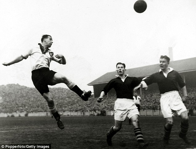 Rising high: Lawton (left) rockets a header towards the Northampton goal in the 1949-50 season