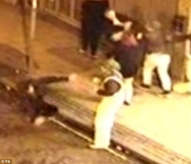 Attack: One of the accused is seen in white dungarees and a green wig while another man falls to the floor
