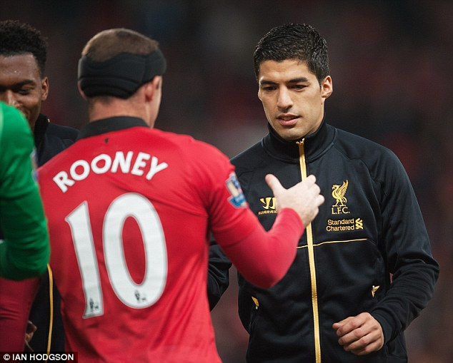Back in action: Man United's Wayne Rooney and Liverpool's Luis Suarez shake hands before the game