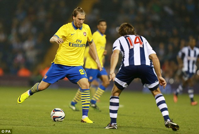 Back in action: Bendtner was making his first competitive Arsenal appearance for 767 days