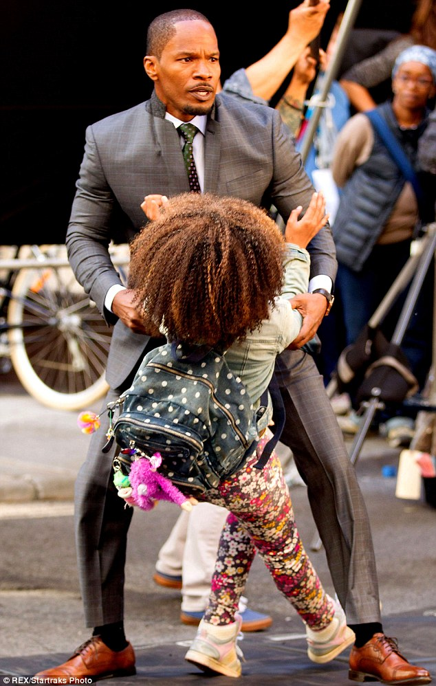 Protector: The actor and singer was seen clutching onto Wallis during the scenes