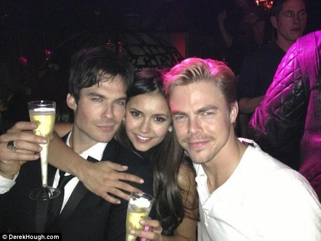 The boyfriend sandwich: Nina pictured pinned between her former beau Ian Somerhalder and new love Derek
