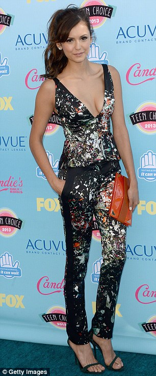 The hot new couple: Nina Dobrev is said to be dating Derek Hough, pictured in August at the Teen Choice Awards in Los Angeles