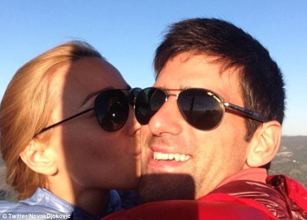 Kiss on the cheek: Djokovic announced his engagement to Ristic (left) on Twitter