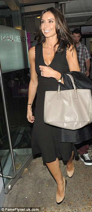 Christine Bleakley looked glamorous in a long black dress which she teamed with nude patent heels