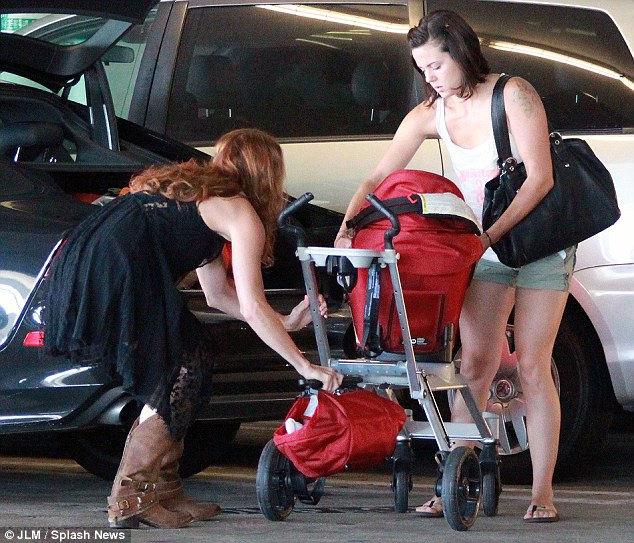 Careful! Amanda wasn't afraid to reach down for supplies from her stroller evn though she wore a dress
