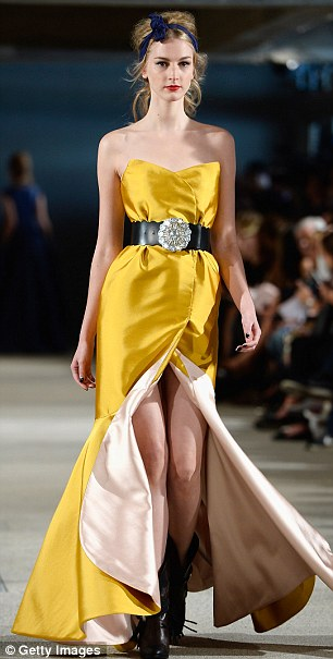 Show-stopper: A stunning gold gown worn with cowboy boots
