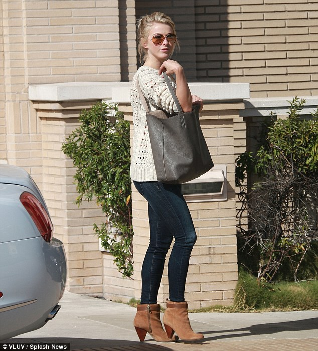 Retail therapy: As news emerged that her brother Derek is dating her friend Nina, Julianne hit up Barneys New York in Beverly Hills on Wednesday