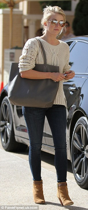 Stylish: The 25-year-old dancer-turned-actress turned heads in skinny jeans, a cable-knit jumper and tan ankle boots