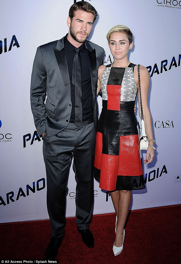 Moving on: Miley says that she hung onto to Liam longer than she should have before moving on; the couple are pictured attending the LA premiere of Paranoia on August 8