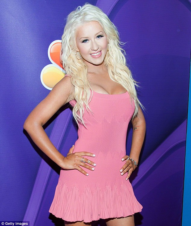 Soundtrack single: Christina Aguilera, shown in July in Beverly Hills, California, revealed on Wednesday that she'll have a new song on the soundtrack of The Hunger Games: Catching Fire due out in November