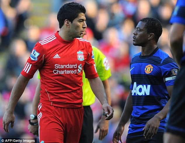 Race row: Suarez (left) served an eight-game ban for racially abusing Patrice Evra (right)