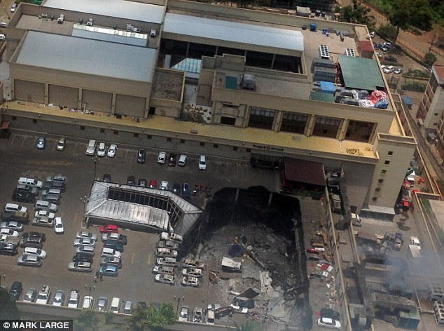 Pictured is the aftermath at Westgate Shopping Mall where the roof of the car park collapsed crushing three floors