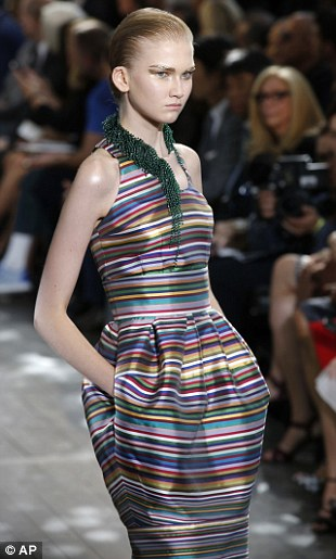 Striped success: Raf Simons offered up tight-waisted dresses in an array of hues at Christian Dior