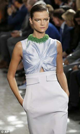 Luxe: A demure dress is given a naughty twist thanks to a tiny cut out that revealed a flash of toned tummy