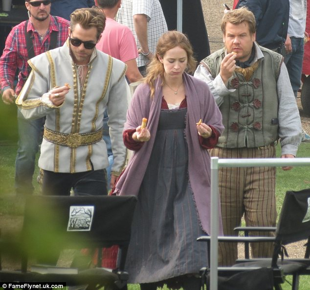 Snack break: Chris Pine, Emily Blunt and James Corden tucked into food on the England set on Wednesday