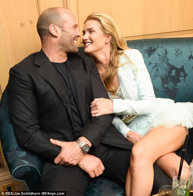 Look of love: Rosie Huntington-Whiteley and Jason Statham cosy up at the Balmain Spring Summer 2014 after show in Paris on Thursday night