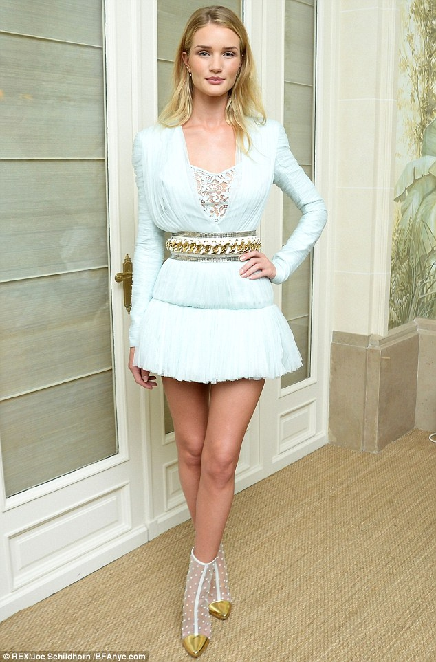 Stunning: the 26-year-old model wore a beautiful mint green dress from Balmain's new collection