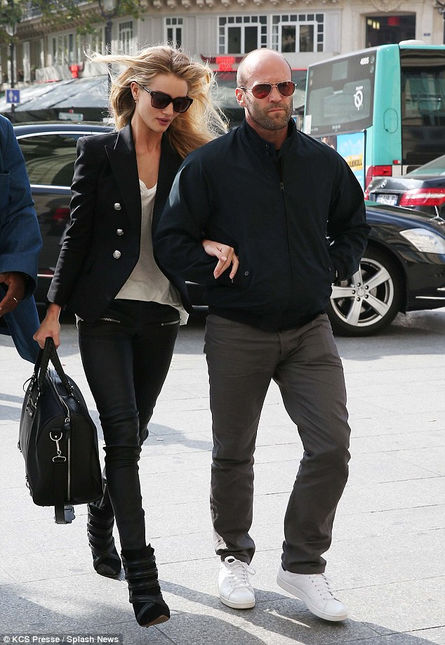 Arm in arm: Rosie and Jason continued their affectionate display as they headed home from Paris