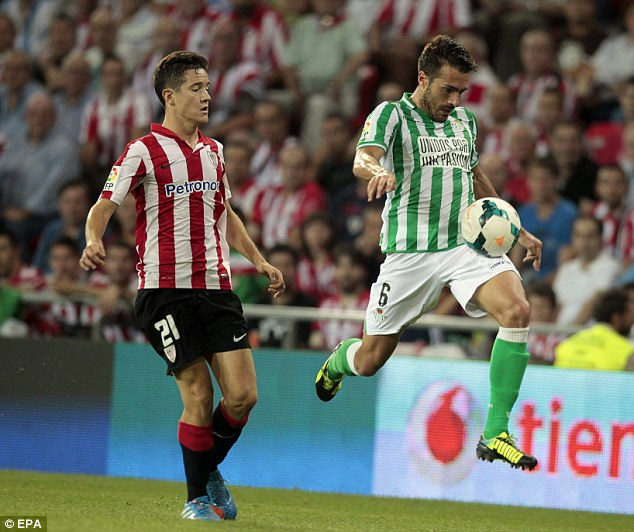 In action: Ander Herrera (left), iagainst Betis midfielder Xavi Torres, will be watched by Manchester United