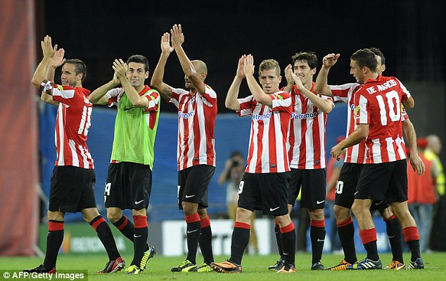 Applause: Athletic Bilbao players lap up the appreciation from the crowd after Thursday's win over Real Betis