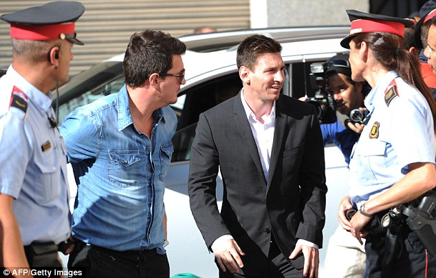 Relaxed: Messi smiles after arriving at court in Gava to face tax evasion charges in September last year