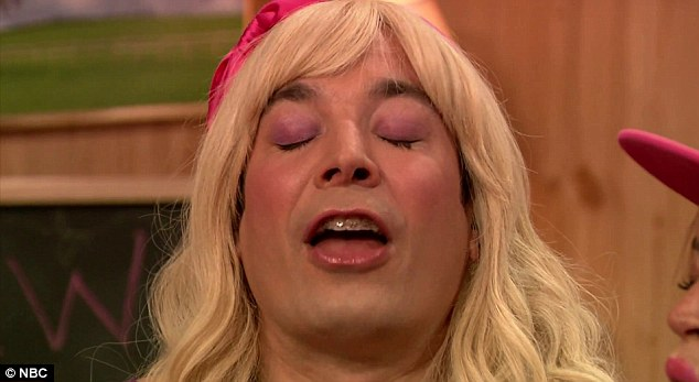 Pretend kiss: Jimmy Fallon closes his eyes and imagines he is with Harry Styles from One Direction