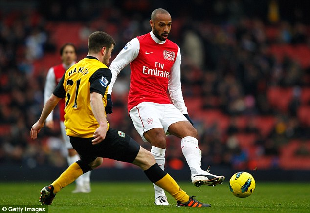 Back in red: Henry returned to Arsenal for a loan spell in 2012 but looks set to see out his career in New York