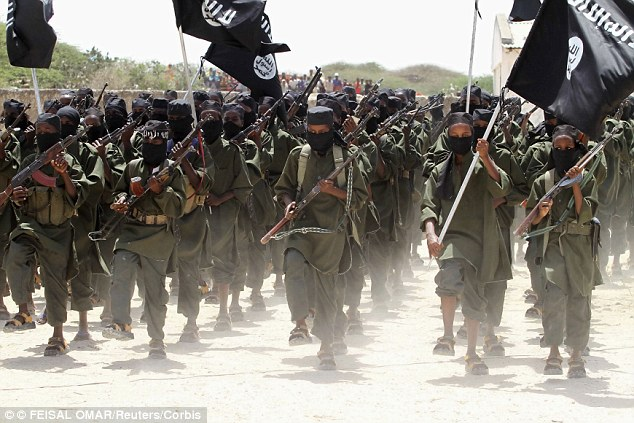 Potential recruiting tool: New recruits belonging to Somalia's al-Qaeda-linked al Shabaab rebel group march during a passing out parade